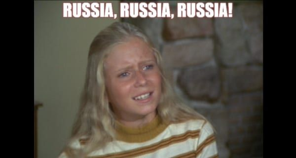 Owning it: Jen Psaki says anyone spreading that pic of her in the pink commie hat is 'simply a puppet of the [Russian] propaganda machine'